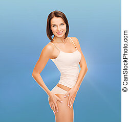 woman in cotton underwear showing slimming concept - health...