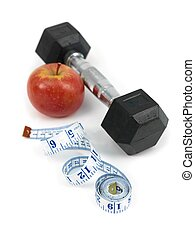 Health And Fitness - A dumbell, apple and a measuring tape ...