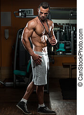 Health and Fitness - Handsome Muscular Man With Jumping Rope...