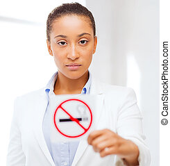 african woman with restriction no smoking sign