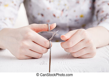 Health and personal care: Hand holding scissors for manicure