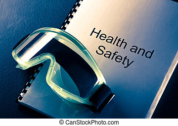 Health and safety document with goggles in toning