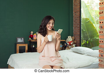 Health asian woman sending message and she sitting on the bed at home