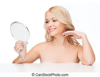 smiling woman looking at mirror