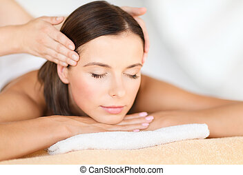 beautiful woman in spa salon - health, beauty, resort and...