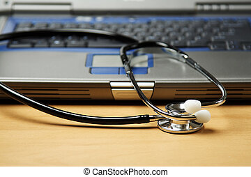 Health care - A stethoscope and a laptop, can be used in...