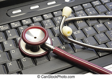 stethoscope on computer keyboard as symbol for management in health care