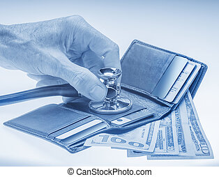 Checking open wallet with stethoscope. Concept of financial crisis or healthcare costs