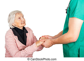 Elderly woman with her helpful medical assistant