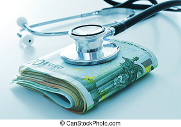 health care industry or health care costs - a stethoscope on...