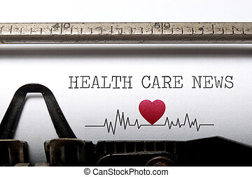 Health care news printed on an old typewriter with heart ...