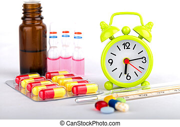 Health care - Picture of a green clock, colourful pills and ...