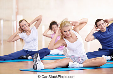 Health care - Attractive young people engaged in fitness