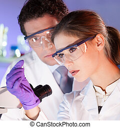 Health care professionals. - Attractive young scientist and...