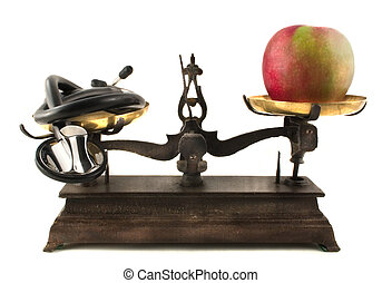 Stethoscope and apple on antique scale