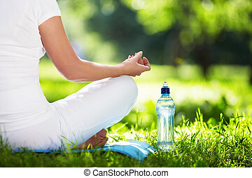 Health-care - Woman in lotus position close-up