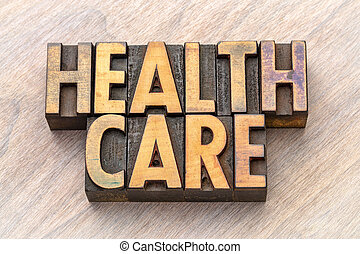 health care word abstract in vintage wood type
