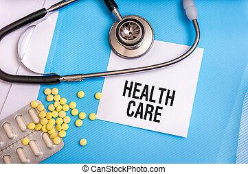 Health care words written on medical blue folder