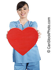 Stock image of female health care worker holding heart