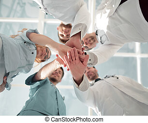 Health care workers demonstrating unity, bottom view