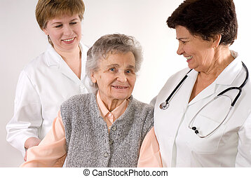 Health care workers and elderly woman needs help