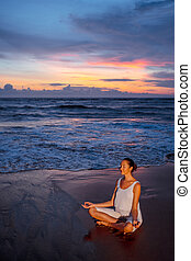 Health-care - Young woman doing yoga on the beach