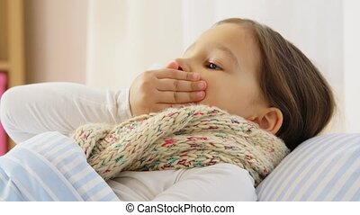 health, children and people concept - sick coughing girl lying in bed at home