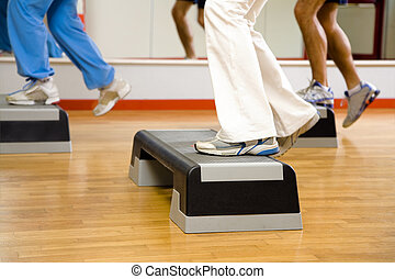 health club: group of people doing aerobics