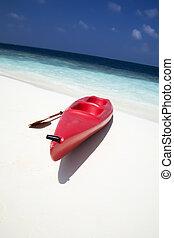 health club - tropical beach: red canoa on the seashore
