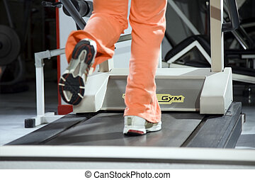 health club: woman running on a tapis roulant