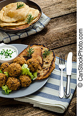 Health crunchy falafel with mint and garlic dip, naan bread ...