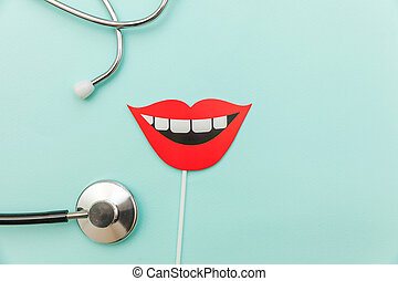 Health dental care concept. Medicine equipment stethoscope or phonendoscope sign of smile teeth isolated on trendy pastel blue background