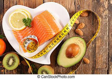 health food- salmon, avocado, almond and kiwi with meter slim concept