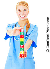 Health Insurance - A picture of a young doctor holding...
