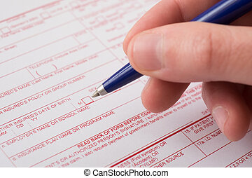 Health insurance claim form and pen