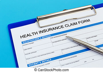 Health insurance claim form with pen