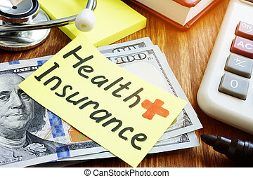 Health Insurance concept. Cash and stethoscope with calculator.