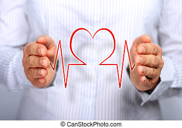 Health insurance concept. Hands and heartbeat.