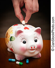 Health insurance - Man throws the tablet in a piggy bank,...