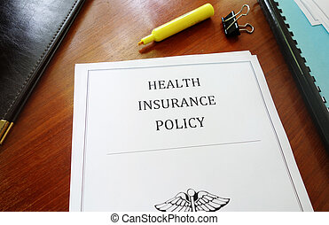 Health Insurance Policy on an office desk...