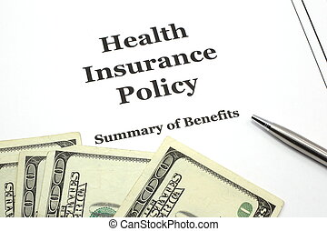Health Insurance Policy with Pen and Cash