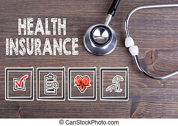 Health Insurance. Stethoscope on wooden desk background.