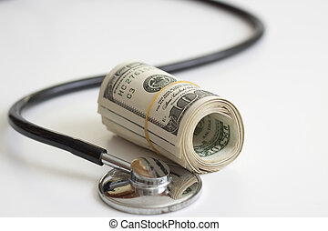 health insurance - a stack of dollars and a stethoscope...