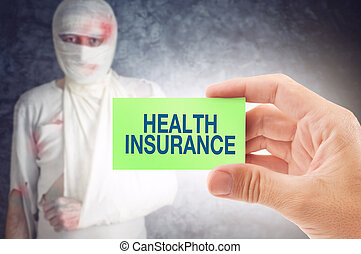 Health Insurance - Doctor holding an business card with...