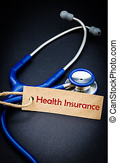 Health insurance word in paper tag with stethoscope.