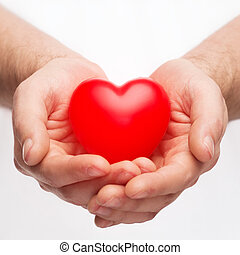 male hands with small red heart
