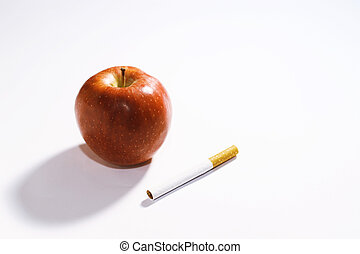 Health mode of life. Red apple and cigarette