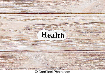 health of the word on paper. concept. Words of health on a wooden background