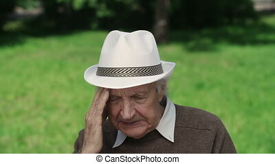 Health Problem - Senior man suffering from headache