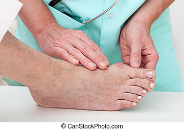 Health problems - Hallux - Nurse checking problems with foot...